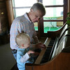 Papa teaching Mason to play the piano at a family reunion.